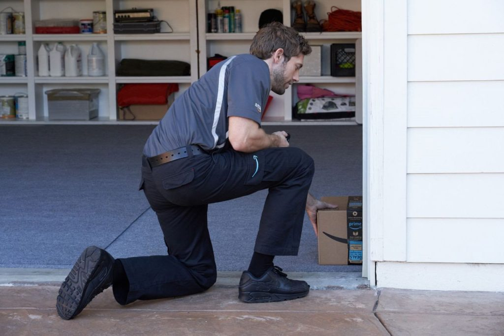 delivery man in garage | ALLIN Home Inspections | smart garage Home Inspection Sterling